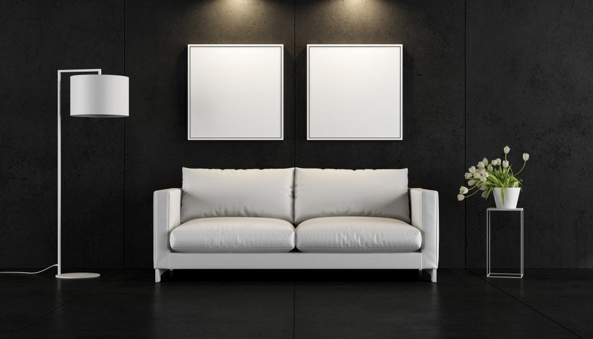 Nietuzinkowe połączenie czarnych ścian i białych mebli