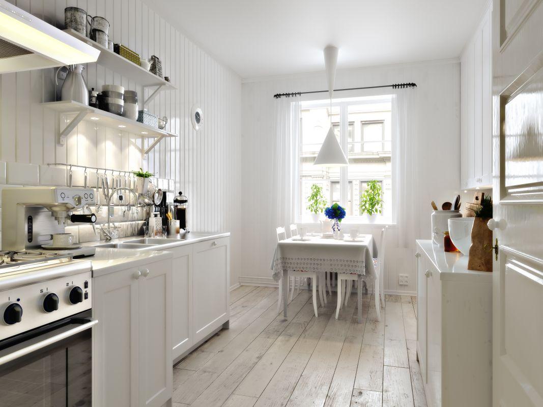 Nieduża kuchnia z charakterystycznymi dla scandi elementami - drewnem i bielą