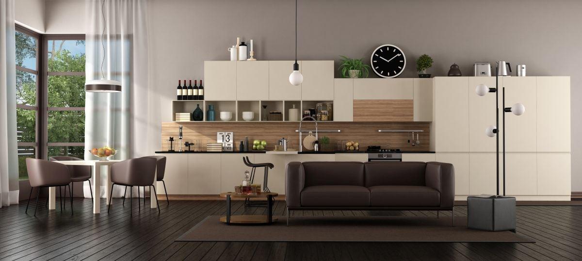 Kuchnia otwarta na salon, dzięki jednolitej podłodze całość jest spójna
